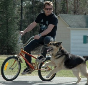 Dangerous Dog Threatening Man on Bike